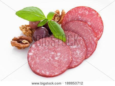 Boiled sausage slice with olives and beans
