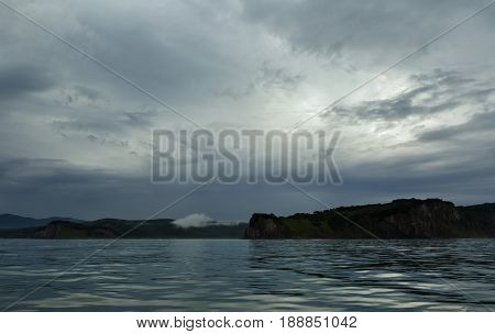 Storm clouds over the coast of Kamchatka in Avacha Bay.