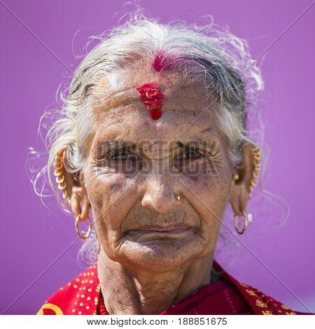 KATHMANDU NEPAL - OCTOBER 07 2016 : Portrait old woman in traditional dress in street Kathmandu Nepal