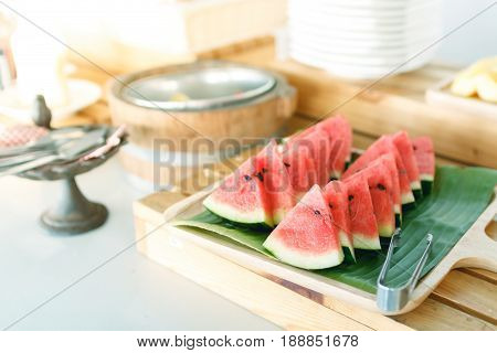 close up piece of watermelon in wooden dish on table