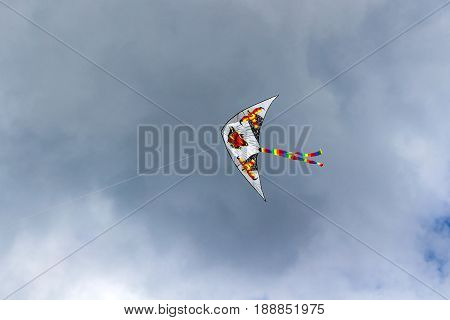 Moscow, Russia - May 28, 2017: Flying Kite On The Cloudy Blue Sky Background
