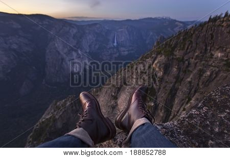 Leather shoes hanging off a cliff in Yosemite
