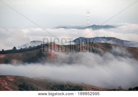 Twin Peaks and Mount Sutro with Sutro Tower in Fog. Shot taken in Mount Tam State Park, Marin County, California, USA.