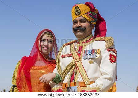JAISALMER INDIA - FEBRUARY 089 2017 : Unidentified woman and man wearing traditional Rajasthani dress participate in Mr. Desert contest as part of Desert Festival in Jaisalmer Rajasthan India. Close up