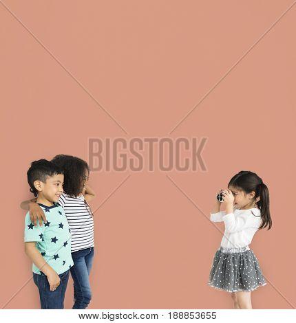 Little Children Taking Photo Friends