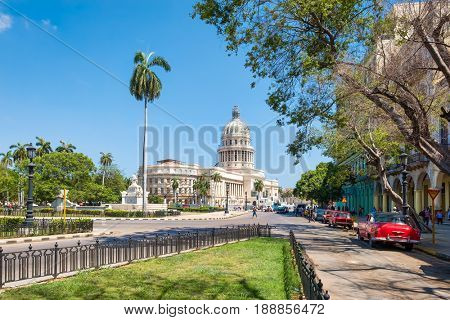 Street scene with a view of the Capitol building in downtown Havana