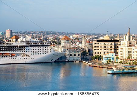 Panoramic view of the  historic center of Havana with a cruise ship docked at the bay