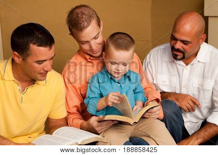 Father reading the bible with his son. Men's Group Bible Study.
