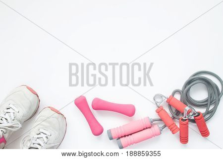 Overhead view of sport bra and sport equipments in pink color healthy lifestyle concept with copy space