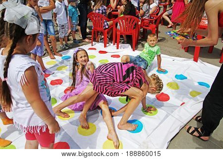 Volgograd Russia - June 01 2014: Children playing twister game on Children Protection Day in Volgograd