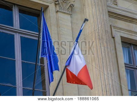 French Und European Flags On A Police Station At Paris