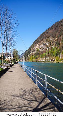 Walking path and bicycle lane along the river of Interlaken