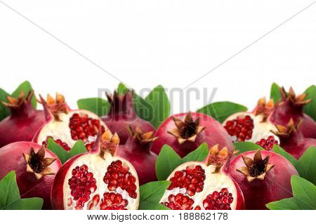 Image of ripe pomegranates and leaves with white background