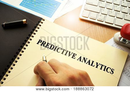 Document with name predictive analytics in an office.