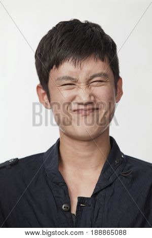 Squinting Chinese man