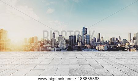 Panoramic Bangkok cityscape in sunrise with concrete floor