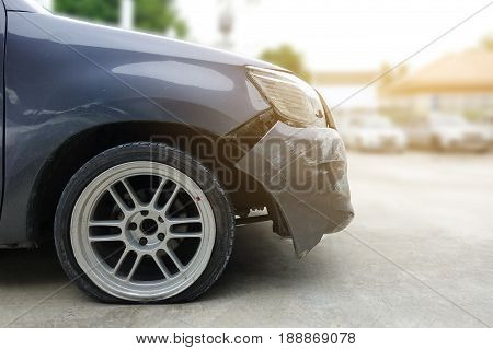 Accident on front bumper and flat tire of black car