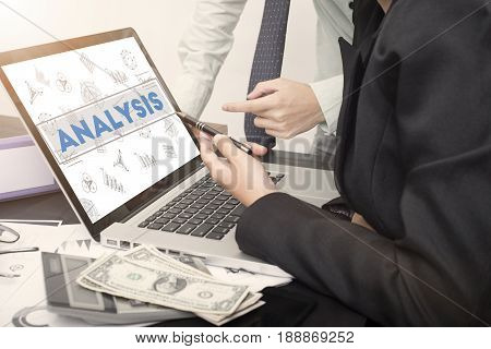 business hand point on a laptop with Analysis homepage on the computer screen finance and banking website web page concept.