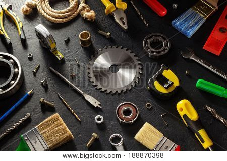 tools and instruments on black background