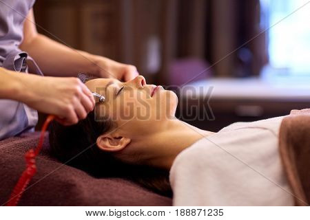 poster of people, beauty, cosmetology and technology concept - beautiful young woman having needle free mesotherapy or hydradermie facial treatment by microcurrent firming device in spa