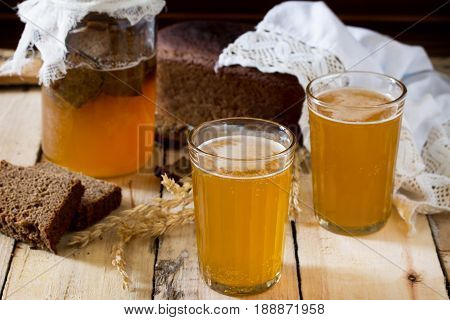 Traditional Russian Cold Rye Drink Kvas In A Glass And A Jug On A Wooden Table. Kvass From Bread, Ry