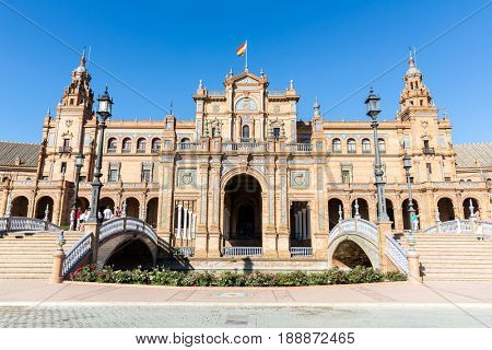 Seville, Spain, Jun 4: Tourists visiting The Plaza de Espana on Jun 4, 2014.This is a plaza located in the Parque de Maria Luisa built in 1928 for the Ibero-American Exposition of 1929.