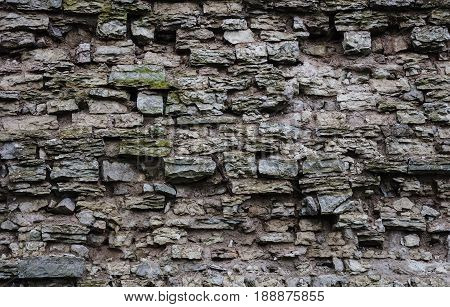 Texture of old destroyed gray brick wall