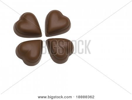 four chocolate hearts on white background