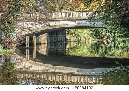 bridge and vegetation reflections in a river