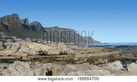 FROM CLIFTON, CAPE TOWN, SOUTH AFRICA, HUGE BOULDERS IN FORE GROUND WITH MOUNTAIN IN THE BACK GROUND 24mnma
