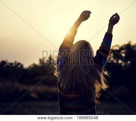 Woman stretching wake up morning sunlight