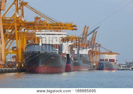 BANGKOK THAILAND - JUNE 272013 : large ship loading container box at klong tuey port in heart of bangkok chao praya river main of capital vessel import -export and transportation industry product