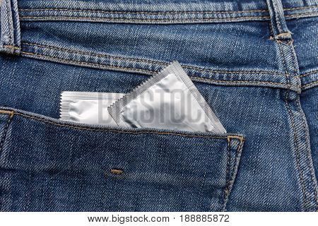 Condom Silver Color In The Pocket Of A Blue Jeans