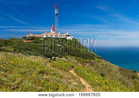 Lighthouse over Atlantic Ocean at Cabo da Roca Portugal. The most western point in continental Europe.