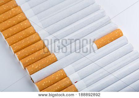 cigarette close up isolated on white background. Drug addiction. Tobacco smoking. cancer. Nicotine. Bad habit.