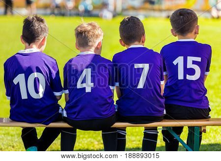 Children Sports Team. Young Boys Sitting on Soccer Bench and Watching Football Match. Soccer Football Tournament for Kids. Sport Education for Children