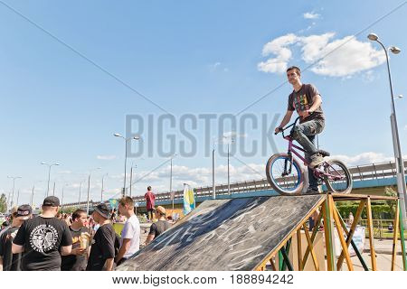 Young Athlete On Bmx Bike Is On The Ramp Ready To Jump