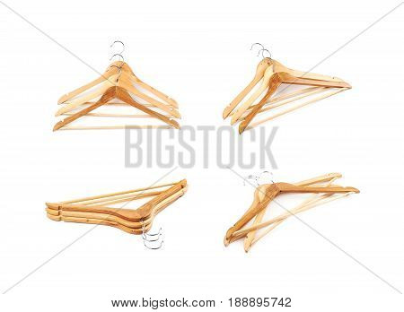 Pile of light wooden hangers isolated over the white background, set of four different foreshortenings
