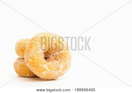 mini donuts sugarsweet pieces of sugar doughnuts on white background Copy space
