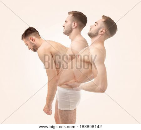Orthopedist concept. Man stretching back on color background