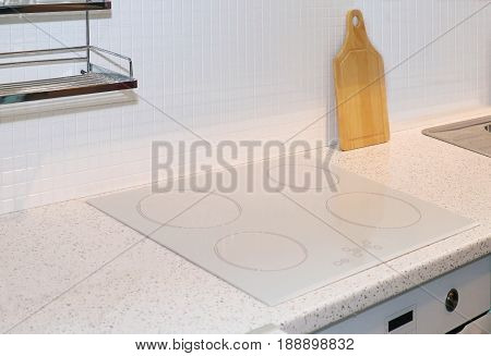 Electric white glass cook top detail in modern kitchen