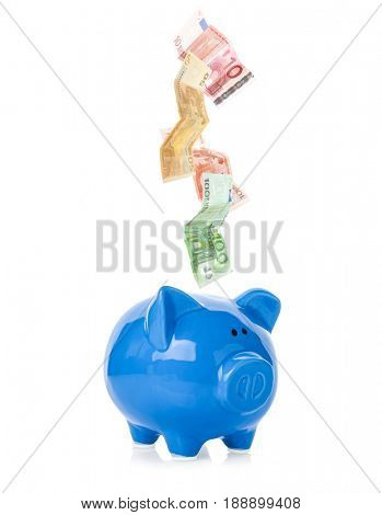 Banknotes falling into piggy bank on white background. Money savings concept