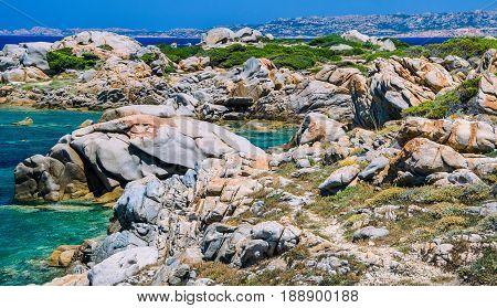 Beautiful Sardinia island landscape with granite rocks and azure coloured bays in Porto Pollo.