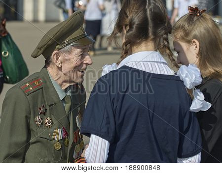 MOSCOW, MAY 9, 2010: Veteran solder portrait with medals on green uniform on celebration of Great victory 65th anniversary in Gorky Park. USSR victory in Second World War. 9 May Victory day