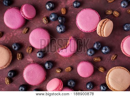 Blueberry macaroons top view. French almond macaroons. Concept macaroon background