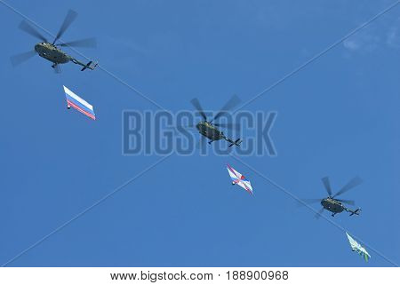 MOSCOW, MAY 9, 2010: Three green helicopters Mi-8 with Russian army flags above Red Square on celebration of Great victory 65th anniversary. USSR victory in Second World War. 9 May Victory day