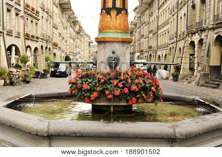 Bern, Switzerland - 17 September 2013: Fountain on the alley to the clocktower on the old part of Bern on Switzerland