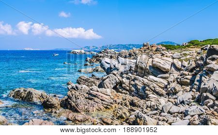 Bizarre granite rocks and amazing azure water on beautiful Sardinia island near Porto Pollo, Sargedna, Italy.