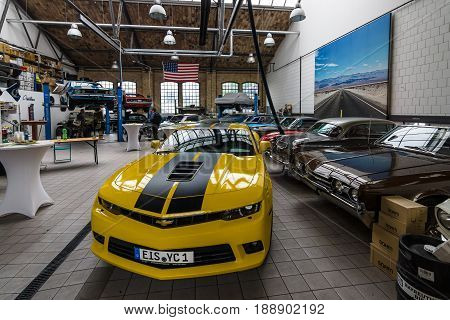 BERLIN - MAY 13 2017: Car workshop for maintenance of classic American cars. Center of competence for classic cars and youngtimers - Classic Remise. Exhibition