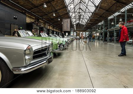 BERLIN - MAY 13 2017: Various retro cars stand in a row in the pavilion of the center of competence for classic cars and youngtimers - Classic Remise. Exhibition